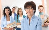 Senior female teacher with group of students - 173438984