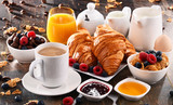 Breakfast served with coffee, juice, croissants and fruits - 173450781
