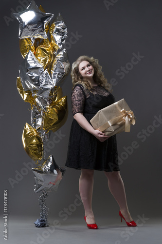 Plus size woman with gift box and balloons Poster