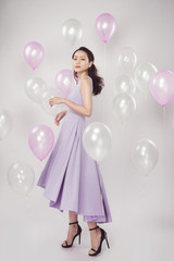 Asian pretty fashionable woman with pastel balloons
