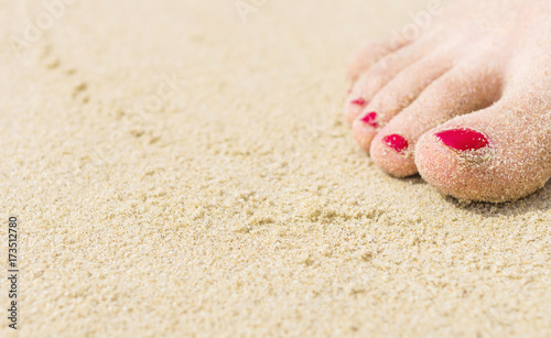Fotobehang Pedicure Woman's feet covered in sand. Selective focus. Travel image for background.