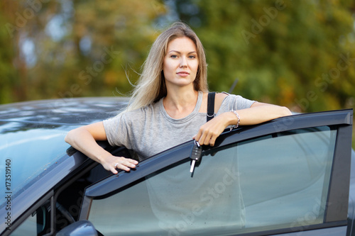 Young traveller woman standing outside car