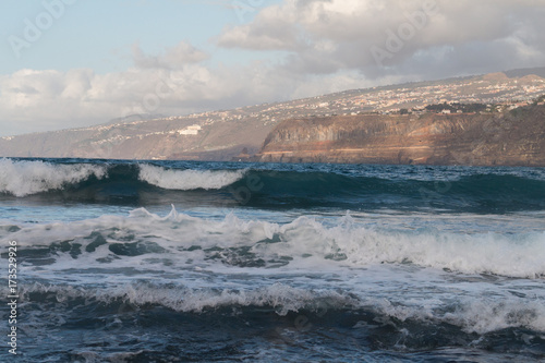 Deurstickers Canarische Eilanden Ocean waves seen from the beach in Puerto de la Cruz in Tenerife