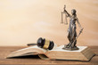 Постер, плакат: Themis statue on open book and gavel next to it