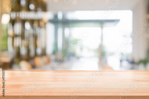 Wood table top on blurred abstract background interior view inside reception hotel or modern hallway for background