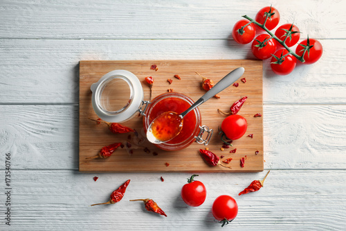 Fotobehang Kruiden 2 Composition with chili sauce on kitchen table