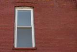Window on red brick wall