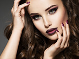 Fototapety Beautiful face of sensual woman with maroon makeup.