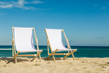 Deck chairs on beach  - 173553126