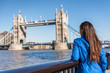 London tourist city travel woman enjoying view of Tower Bridge. Urban lifestyle tourism Europe destination vacation person enjoying view of famous attraction, England, Great Britain, UK. - 173556720