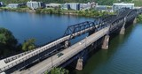 A slowly rising aerial view of the Hot Metal Bridge over the Monongahela River on Pittsburgh's South Side.	 	 - 173576148