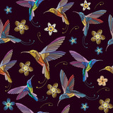 Humming bird and flowers embroidery seamless pattern. Beautiful hummingbirds and exotic flowers embroidery on black background. Template for clothes, textiles, t-shirt design - 173629370