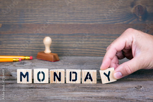 Monday. Wooden letters on the office desk, informative and communication background.