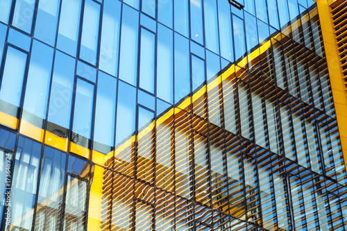 contemporary glass facade with reflection. urban architecture.