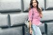 Fashion model walking on the city street - 173655105