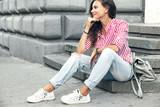 Fashion model walking on the city street - 173655110