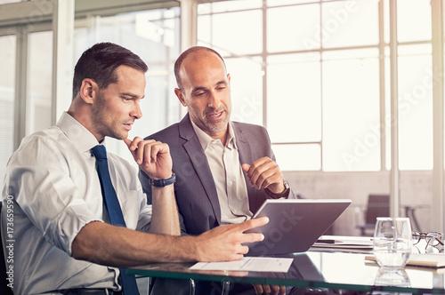 Businessmen working on digital tablet
