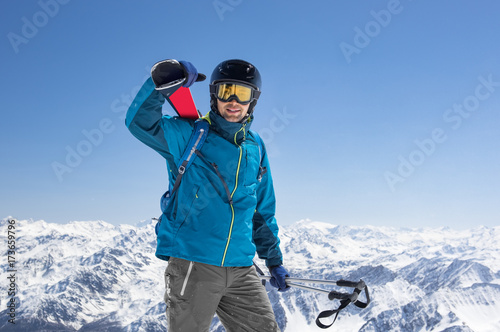 Man carrying ski equipment