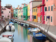 canal and the colorful houses of the BURANO island near Venice i