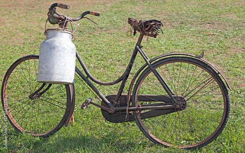 Poster Schip very old milking bicycle with aluminum milk canister