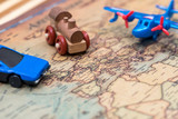 small toy - car, plane and train on map
