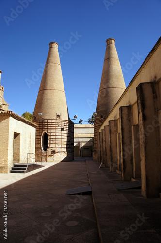 Chimneys for tiles production in the Monastery of Santa Maria de las Cuevas on Cartuja island (Isla de la Cartuja) in Sevilla (Seville), Spain. Ceramic factory of tiles and modern art museum.