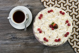 Traditional tasty christmas white cake and cup of black tea - 173676115