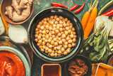 Chickpeas in bowl and various healthy  cooking ingredients. Vegan or vegetarian food and eating concept - 173684938