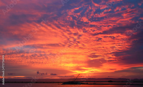 Foto op Aluminium Crimson Sunset, Beach view, A bridge in the middle of the sea