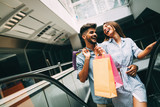 Happy attractive loving couple enjoy shopping together - 173758721