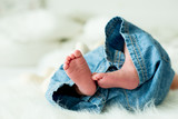Little baby boy feet, baby lie down in bed in the afternoon - 173768955