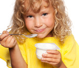 Little girl eating yogurt - 173774124