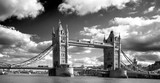 Tower Bridge spanning the River Thames with a dramatic cloudy sky