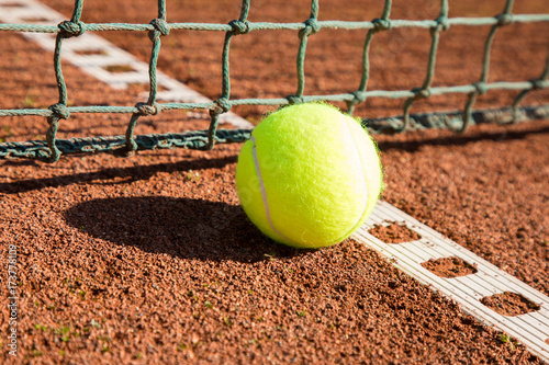 Aluminium Tennis tennis ball with line and net on a sand court