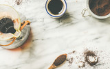 Morning black filtered coffee in Chemex and white cup on light grey marble table background, copy space, top view, flat-lay. Alternative coffee brewing concept - 173779119