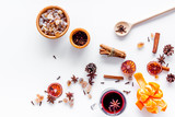 Celebrate new year winter evening with hot drink. Mulled wine or grog ingredients. White background top view. - 173782732