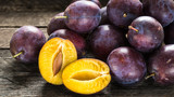 Fresh blue plums on wooden table - 173794545