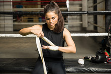 Woman doing a hand wrap before boxing