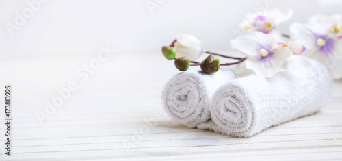 SPA setting with bath towels and orchid flower, selective focus - 173813925