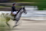 Abstract image with a moving rider and horse at show jumping - 173815778