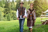 Couple in traditional ukrainian clothes in the Carpathians - 173823130