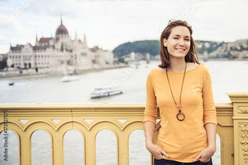 Fotobehang Boedapest Young happy woman standing on bridge in Budapest, Hungary