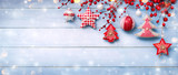 Christmas Ornaments Hanging On Snowy Wooden Plank - 173833151