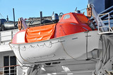 Safety lifeboat on ship deck - 173843580