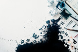 Header with spilled ink, crumpled paper, scattered letters, papers and notepads on a white wooden background. Creative writing concept. Flat lay with copy space. - 173865754
