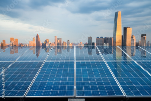 solar energy panel with city twilight - 173867500