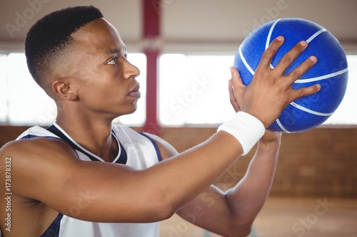 Fotobehang Basketbal Close up of teenager practicing basketball