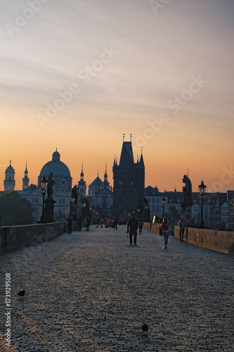 Poster Praag Prague, The Czech Republic: AUGUST 23, 2017- Charles Bridge in the early summer morning. The first tourists appeared on the bridge