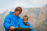 father and son travel hiking in mountains of Norway - 173945917