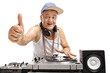 Elderly DJ playing music and making thumb up sign